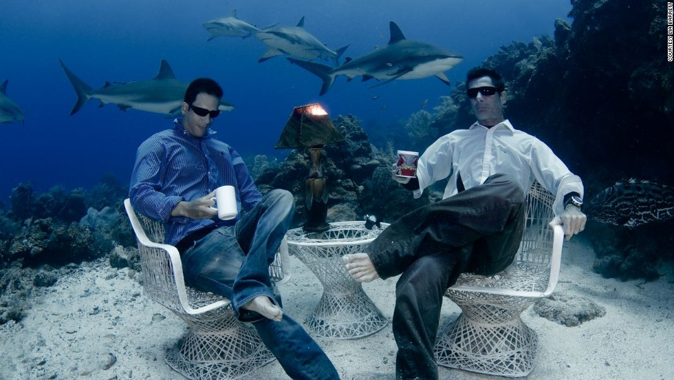 See those sharks swimming in the backgroud? Yep, they're real. The casually dressed men sipping coffee underwater? Real too. Welcome to the remarkable real life water world.