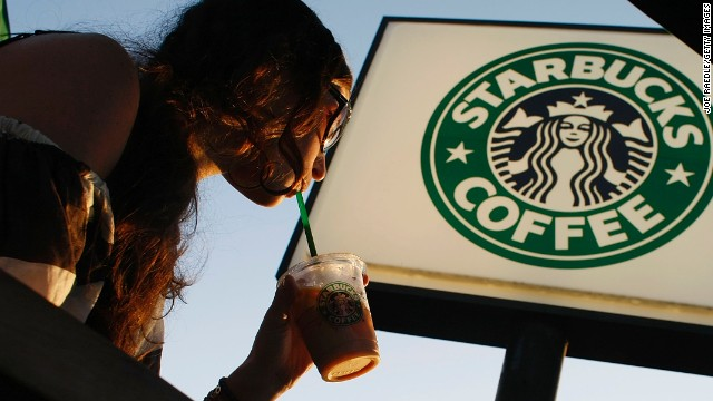 A customer drinks a beverage at a Starbucks in Miami, Florida. Shannon Watts and Kate Beck want the coffee shop to ban guns.