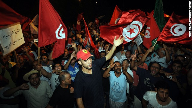 People outside the headquarters of the Constituent Assembly to demand ouster of the Islamist government on July 28, 2013 in Tunis.