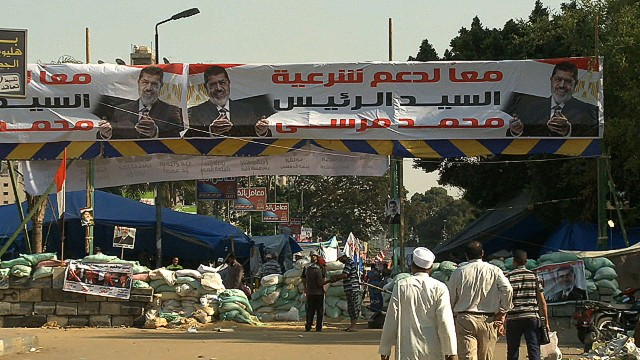 Pro-Morsy camp digs in