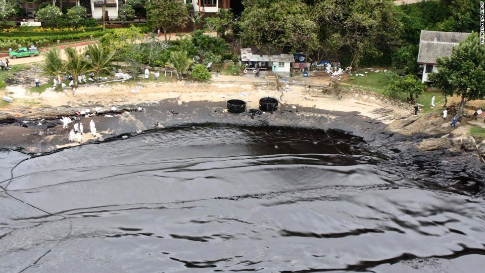 Blacked water laps onto the beach in front of a resort on the island of Koh Samet on Monday, July 29. Tourists have been evacuated from the popular Thai weekend destination.