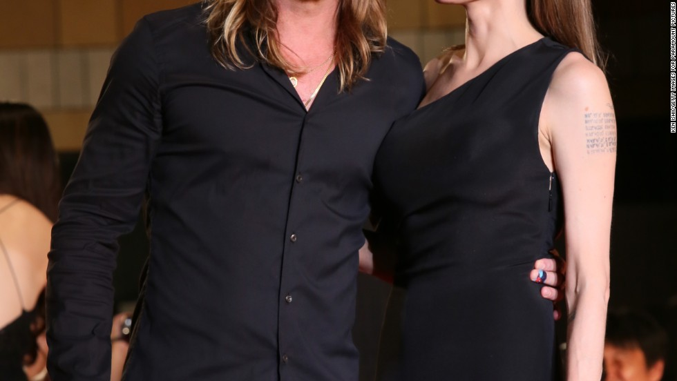 "Brad Pitt and Angelina Jolie arrive at the Tokyo premiere of ""World War Z"" in matching black outfits on July 29."