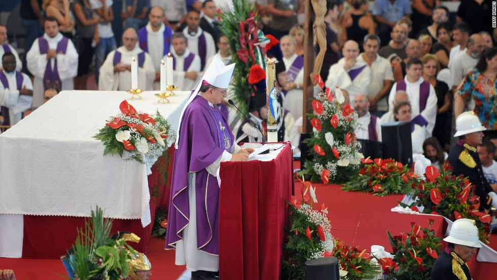 Gennaro Pascarella, the local bishop, addresses the funeral in Pozzuoli on July 30.