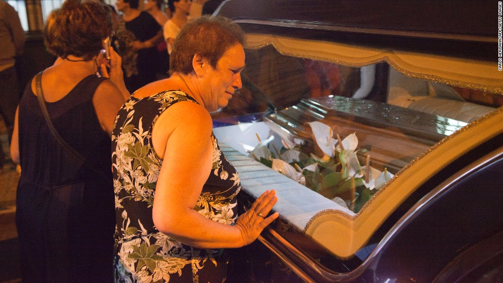 A woman is among the mourners in Pozzuoli on July 29.
