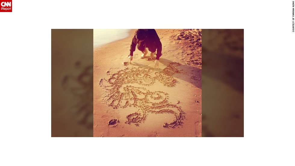 "In this photo Farrah Azam can be seen drawing one of her henna designs in the sand at a beach in Antalya, Turkey. The 26-year-old <a href=""http://statigr.am/viewer.php#/user/254704119/"" target=""_blank"">henna artist from London</a> creates bespoke designs but unusually she paints it on canvases and other objects rather than on body parts. <br /><br />""I am a practicing Muslim who participates in the month of fasting. Eid marks the end of the month of fasting and I celebrate it with my family and friends by visiting the mosque for the special Eid prayer, having a lavish meal, exchanging gifts and meeting relatives,"" she said."