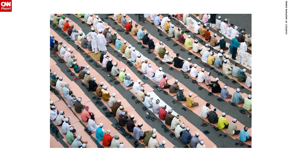 "Anupama Kinagi, 37, shot this photo of Muslims in prayer from a terrace near the Hamidiya Masjid mosque in <a href=""http://ireport.cnn.com/docs/DOC-1012390"" target=""_blank"">Mumbai, India</a>. He said he wanted to capture the geometric pattern formed by so many bowed heads and bodies: ""It was a beautiful morning. The sky was clear. There were hundreds of men gathered to prayer as a ritual. The men were dressed in Kurta Pajama. The place was noisy but as soon as the prayers started it was so peaceful and pin drop silence. After the prayers everyone hugged and greeted each other 'Eid Mubarak'."""