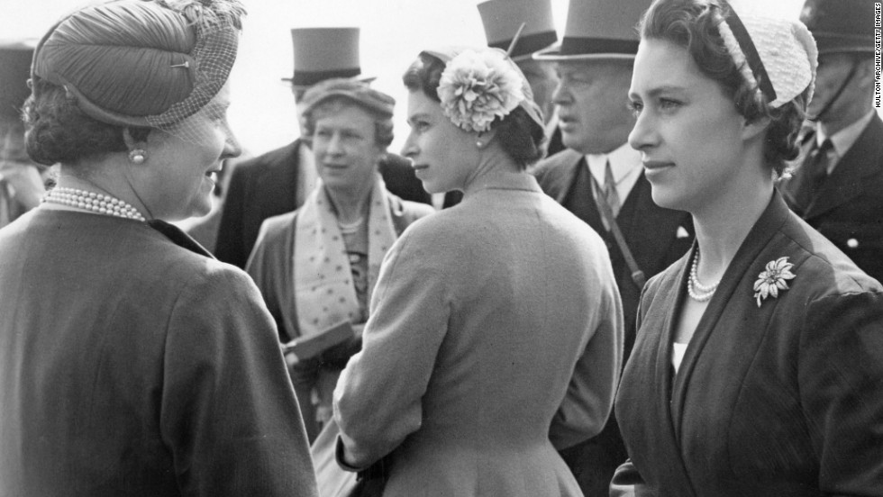 Here Queen Elizabeth is flanked by her mother and her late sister Princess Margaret (right) at the Epsom Derby in 1955.