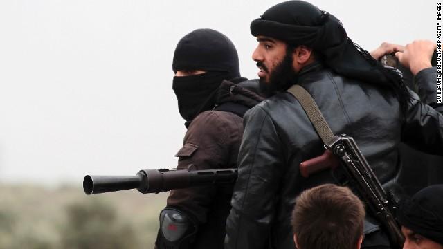 Al Nusra fighters stand ready to fight Syrian regime forces near Aleppo in April. Al Nusra has pledged allegiance to al Qaeda.