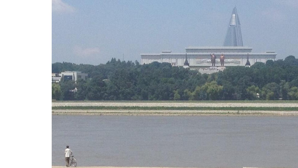 Brass statues of deceased North Korean rulers Kim Il Sung and his son Kim Jong Il loom large over Pyongyang.