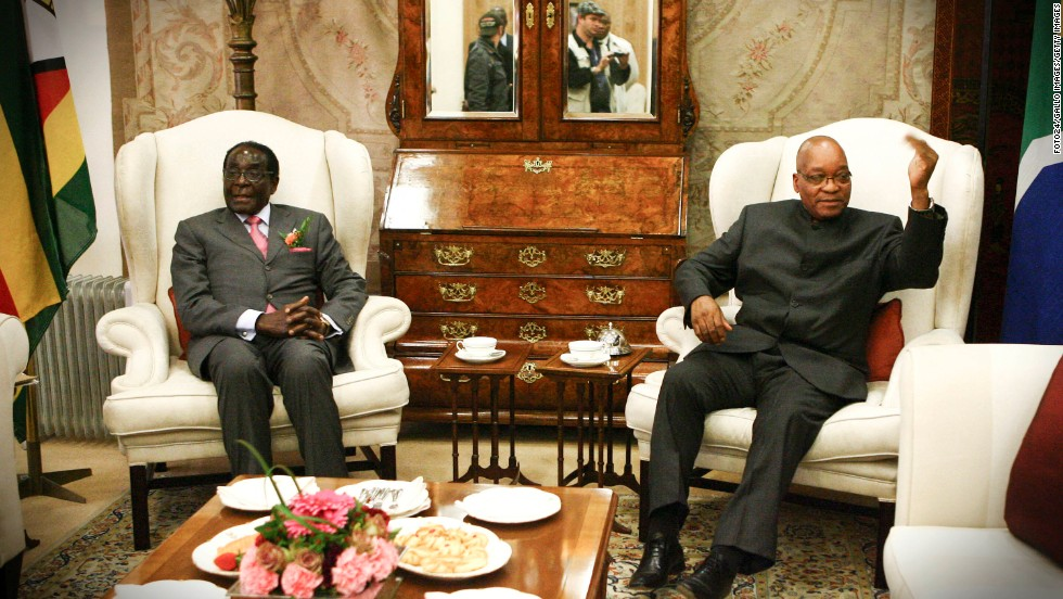 South African President Jacob Zuma meets with Mugabe in June 2011 in Pretoria, South Africa.