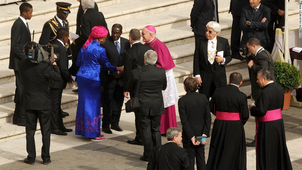 Mugabe and his wife arrive at the John Paul II Beatification Ceremony in May 2011.
