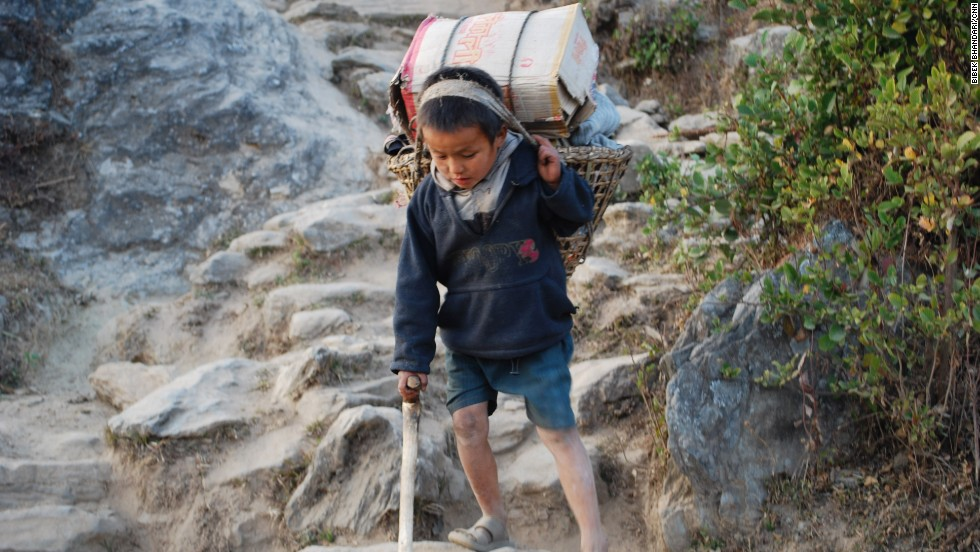 Though child labor is illegal in Nepal, an estimated 1.6 million children between 5-17 years are in the work force, according to the Nepal Child Labor Report. This 2010 photo shows a boy working as a porter in Nepal's Solukhumbu district.
