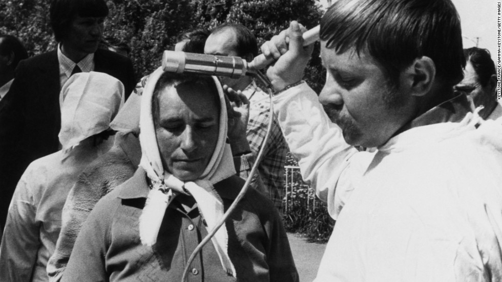 People are scanned for radioactivity before evacuating the Ukraine in this undated photo.