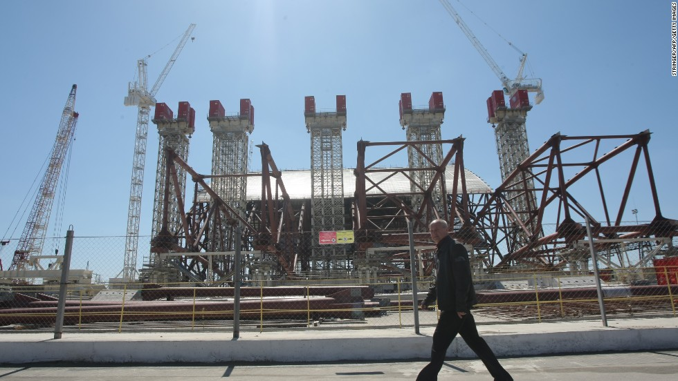 Twenty-seven years after the nuclear disaster, engineers work on April 26, 2013, to construct a colossal arch-shaped structure to permanently cover the exploded reactor.