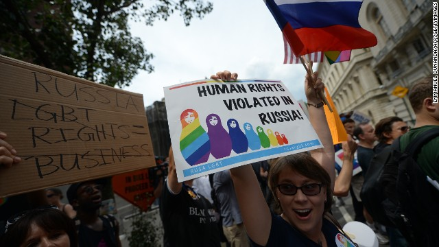 Protesters hold a demonstration against Russian anti-gay legislation and against Russian President Vladimir Putin stands on gay rights, in front of the Russian Consulate in New York, July 31, 2013. Protesters called for a boycott of Russian products and ask the Russian government to repeal the anti-gay propaganda law before the 2014 Winter Olympics in Sochi. AFP PHOTO/Emmanuel Dunand (Photo credit should read EMMANUEL DUNAND/AFP/Getty Images)