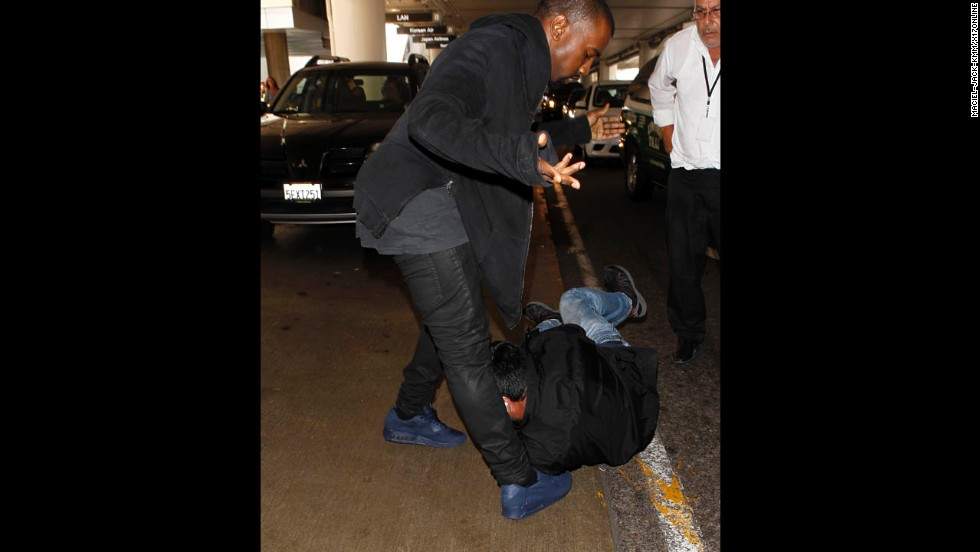 """Kanye West has turned his <a href=""""http://www.mtv.com/news/articles/1707444/kanye-west-paparazzi-rant.jhtml"""" target=""""_blank"""">legendary issues with the paparazzi into part of his on-stage act</a>. The rapper <a href=""""http://www.cnn.com/2009/SHOWBIZ/Music/10/23/kanye.west.hearing/index.html"""">was arrested in 2008 after a scuffle with a photog at Los Angeles International Airport</a>, and this year <a href=""""http://marquee.blogs.cnn.com/2013/06/07/kim-k-photogs-are-threatening-my-life/?iref=allsearch"""">has had repeated issues with L.A. paps</a>. The latest came in July when he got into another <a href=""""http://www.tmz.com/videos/0_yzmcgvcj#!id=0_yzmcgvcj"""" target=""""_blank"""">physical altercation with a paparazzo at the airport</a>."""