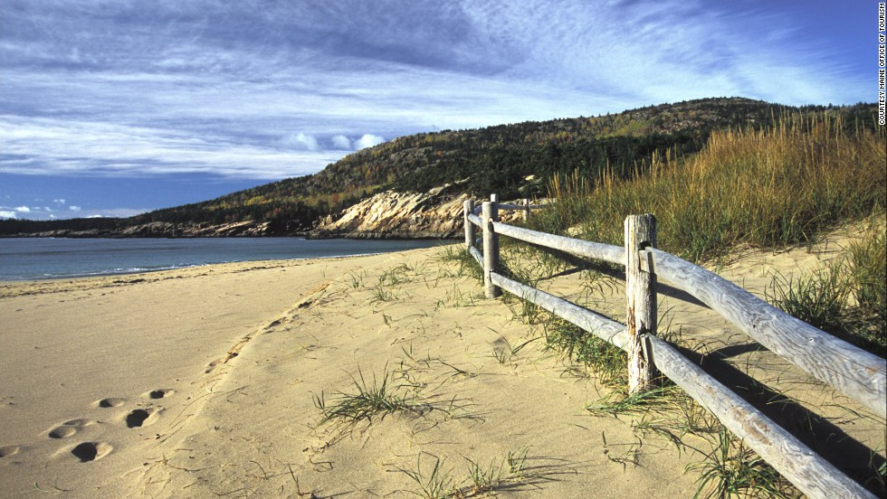 Acadia National Park's Sand Beach in Maine consists mostly of sand made from the ocean surf pounding on shell fragments for thousands of years. There are hiking trails on both sides of the beach.