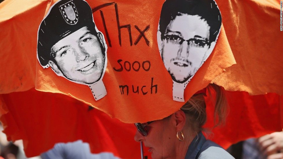 "Demonstrators in Berlin hold a protest march on Saturday, July 27, in support of Snowden and WikiLeaks document provider Bradley Manning. <a href=""http://www.cnn.com/2013/08/01/us/snowden-manning/index.html"">Both men have been portrayed as traitors</a> and whistle-blowers. Manning was acquitted on July 30 on the most serious charge of aiding the enemy, but he was convicted on several other counts and likely faces a lengthy term in a military prison."