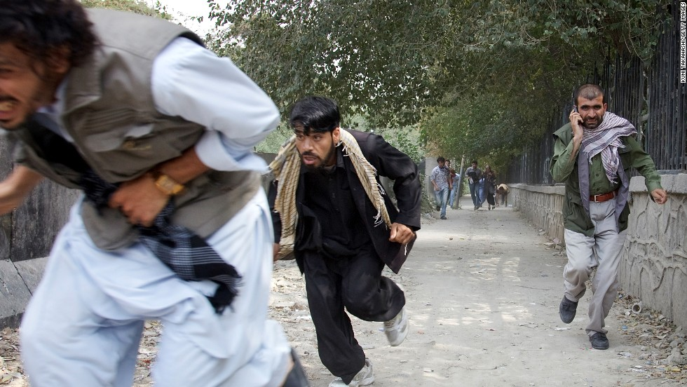 "People flee the scene of a Taliban attack on the <a href=""http://news.blogs.cnn.com/2011/09/13/u-s-embassy-in-afghanistan-attacked-taliban-claims-responsibility/"">U.S. Embassy in Kabul, Afghanistan,</a> on September 13, 2011. Three police officers and one civilian were killed. There were no reports of U.S. casualties."