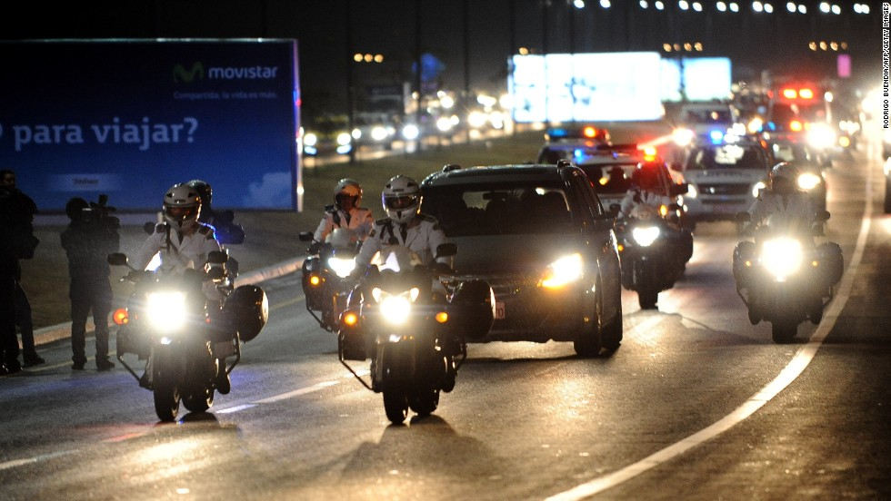 A motorcade carries the coffin of Ecuador football star Christian Benitez through the capital Quito.