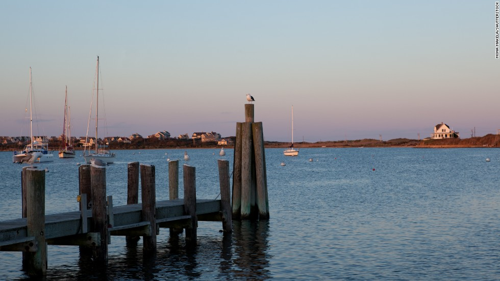 "Twelve miles off the coast of <a href=""http://www.blockislandinfo.com/"" target=""_blank"">Rhode Island, Block Island</a> features 17 miles of beaches (all free, as is parking) as well as two harbors for boaters. Sunset at Great Salt Pond is shown here."
