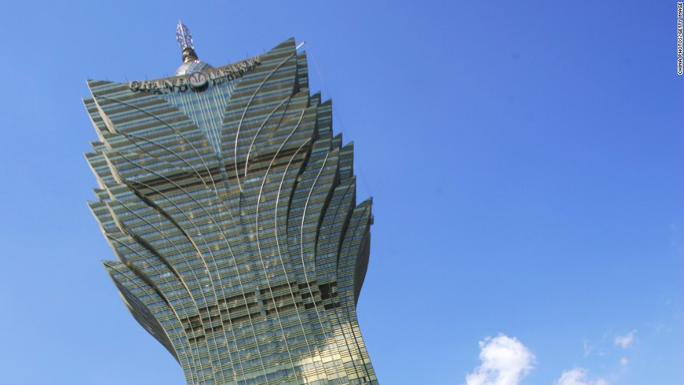 <strong>Height</strong>: 261 meters.<br /><strong>Cost to build</strong>: $385 million.<strong><br />Completion date</strong>: 2008.<br /><strong>Fast Fact</strong>: Designed by Hong Kong architects Dennis Lau and Ng Chun Man, the golden structure combines the visual effects of crystals, fireworks and the long plumes of a Brazilian headdress -- all symbols of prosperity to guide the money home.