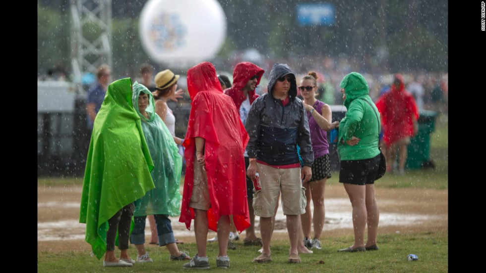 Brightly colored ponchos protect Lollapalooza patrons from a brief rain shower on August 2.