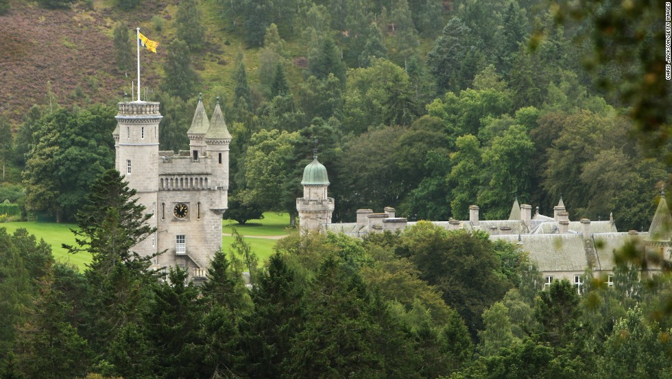 The Royal Standard flies from the turrets of Balmoral Castle in Ballater, Scotland, when the Queen is in residence. Cottages on Balmoral Estate are available for rent to regular vacationers.