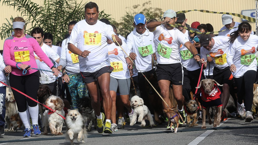 "Dogs with their owners participated in the dog race ""Caorrida"" in Sao Paulo."