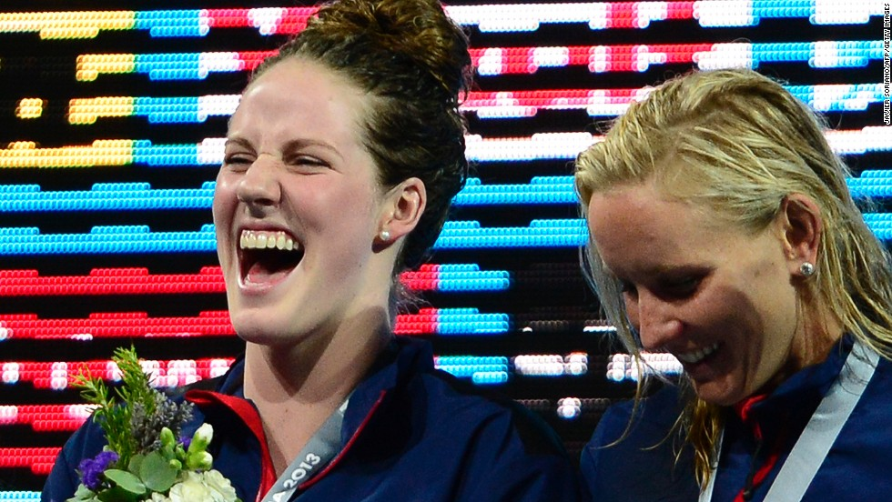 Missy Franklin, left, enjoys her spot at the top of the medal rostrum after winning gold as part of the U.S. women's 4 x 100 meter medley relay team at the world swimming championships in Barcelona. It was her sixth victory of the meet, setting a new record total for a female swimmer.
