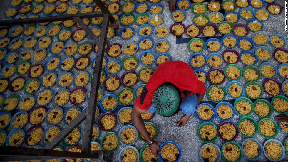 A young man arranges bowls of food before Iftar in Pakistan's second largest city Lahore. Pakistan is the world's second most populous Muslim country; Indonesia has the highest percentage of Muslims.