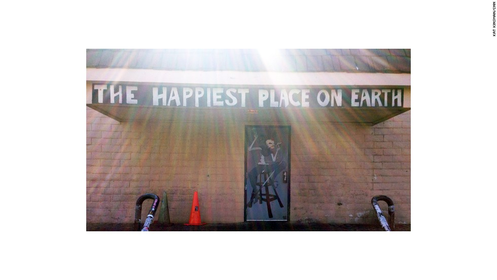 "A message on the front entrance of the Double Down Saloon declares the 24-hour dive bar and music venue to be ""The Happiest Place on Earth."" It is correct."