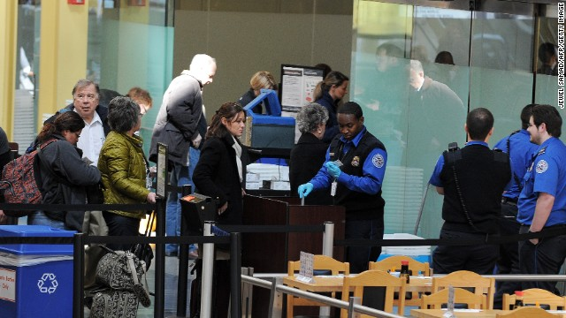 Transportation Security Administration officers work at the Ronald Reagan National Airport in Washington, D.C., on March 4.