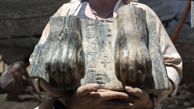 Australian excavation volunteer Joshua Talbot displays the remains of a Sphinx with a hieroglyphic inscription between its paws dating circa 3rd century BCE, found during excavation in the Northern Israeli archeological site of the ancient Tel Hazor, revealed on July 9 2013