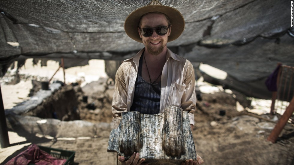 Joshua Talbot, 25, an out-of-work archeology graduate from Australia, is volunteering for a second summer. Volunteers endure hard work for no pay, but the digs are considered experiences of a lifetime.