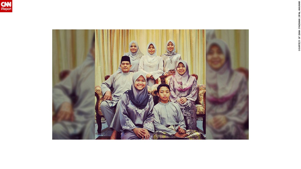 "Dina Syazwani Sipal Anuwar, a 24-year-old teacher from <a href=""http://statigr.am/viewer.php#/user/175523476/"" target=""_blank"">Selangor in Malaysia</a>, took this photo of her family celebrating Eid last year. The photo means a lot to her as it was the last Eid she was able to spend with her father Sipal, a policeman, who unexpectedly passed away in January 2013. It was also the first time the family had ever managed to color coordinate their outfits. ""I think it was one of the signs that father would be leaving us, last Eid we could take a perfect photo as a whole family,"" said  Dina, pictured top left. This year the family have decided to all wear pink."