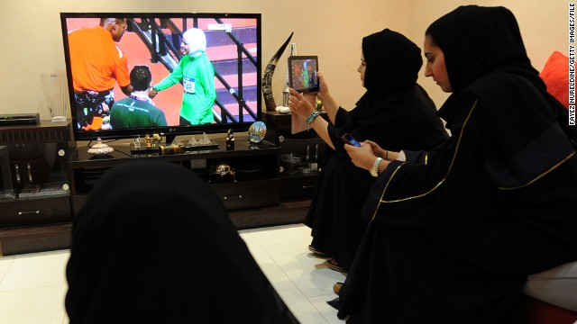 Saudi women in a Riyadh house watch Sarah Attar represent their country at the London 2012 Olympics.
