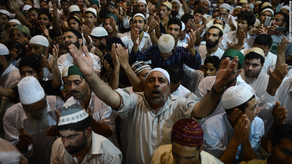 Men pray during a special prayer service for Lailat al-Qader, also known as the Night of Power, at Jamia Masjid, a mosque in Srinagar, India, on August 6.