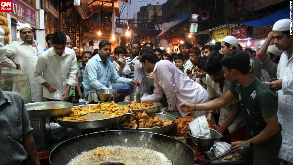 "The hustle and bustle of the <a href=""http://ireport.cnn.com/docs/DOC-1012895"" target=""_blank"">Matia Mahal bazaar</a> close to Old Delhi's principal mosque Jama Masjid was captured on film by 70-year-old Ramesh Lalwani. The samosas are in the process of being fried and the pakoras, jalebis and gulab jamuns are ready for sale to the Eid crowds."