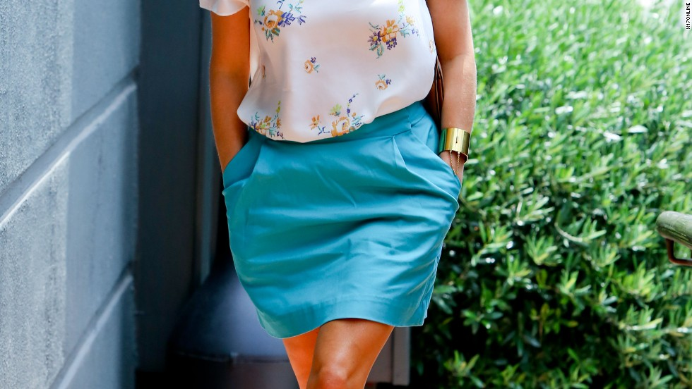 Reese Witherspoon keeps it classy in a blouse and skirt while stepping out in Los Angeles on August 2.