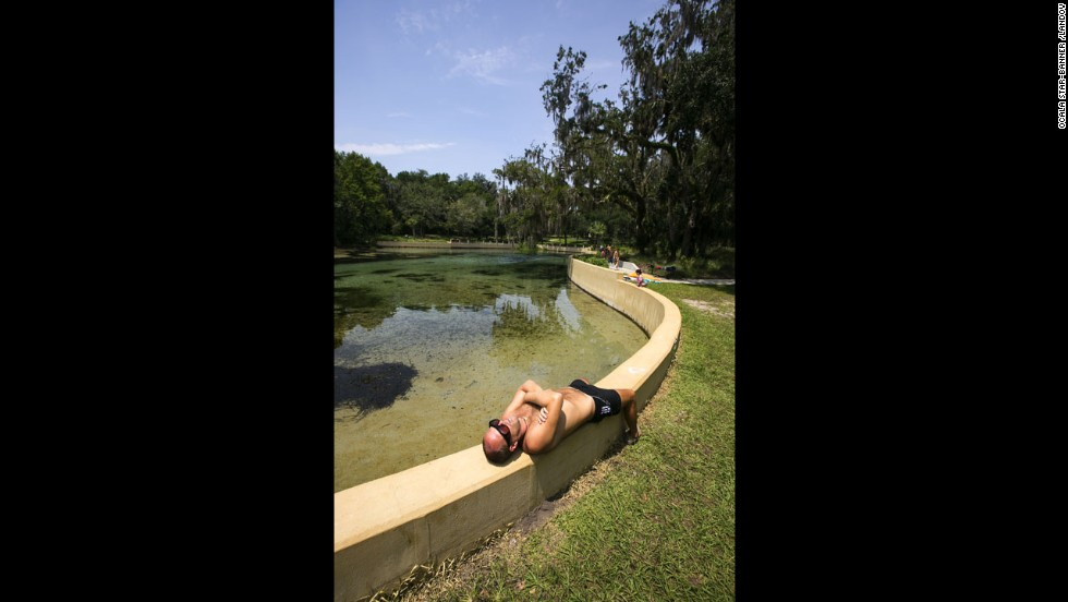 A man takes a nap at a recreation area in Salt Springs, Florida, on August 6.