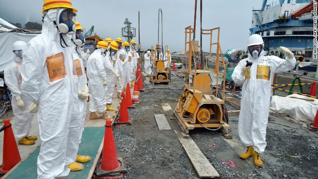 Local government officials and nuclear experts inspect a construction site at Fukushima Dai-ichi nuclear plant.