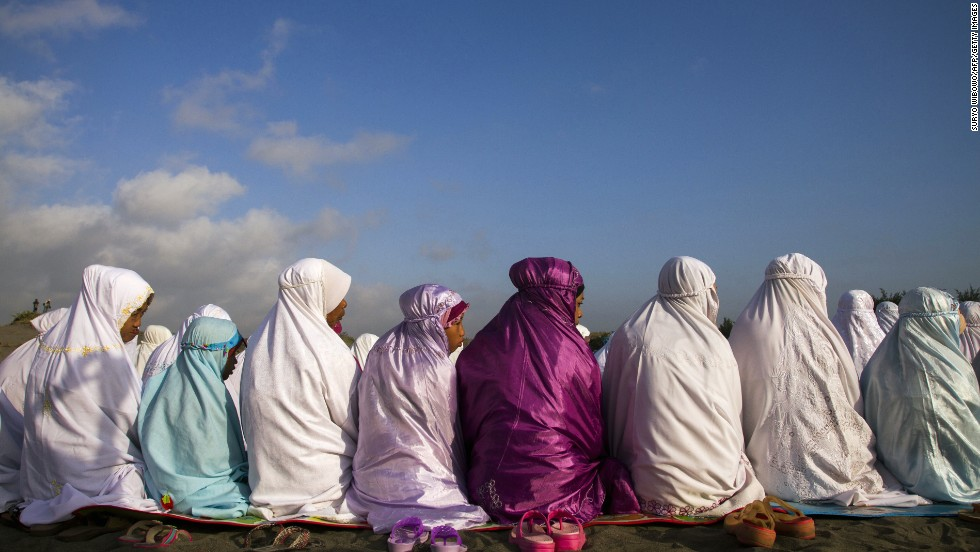 Indonesian Muslims attend early morning Eid al-Fitr prayers near the coast in Bantul, Yogyakarta in central Java island on August 8.