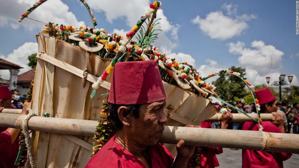Royal servants carry gunungan wadon during the ceremony on August 8. Receiving part of the Gunungan is believed to be good luck and a blessing for the year ahead.