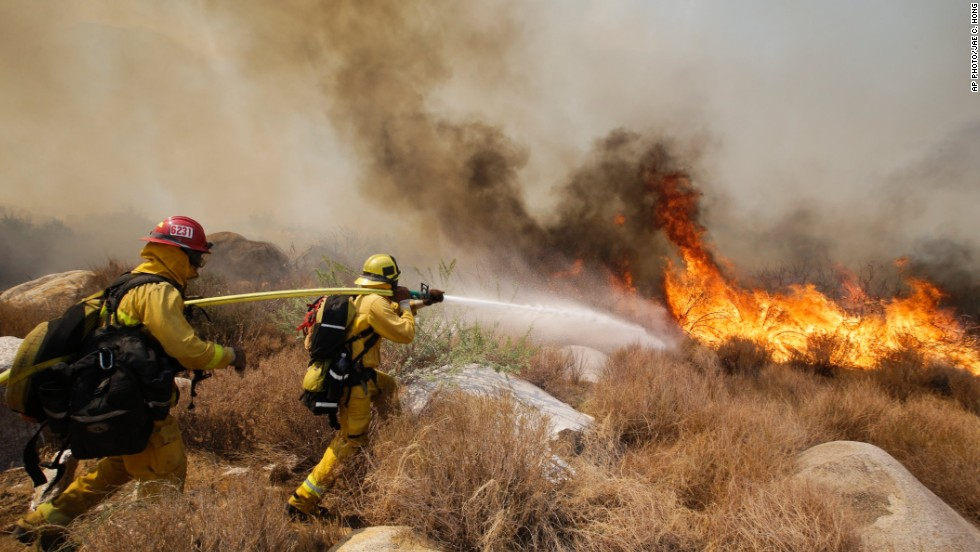 "AUGUST 9 - CABAZON, CALIFORNIA: Firefighters battle a <a href=""http://cnn.com/2013/08/08/us/california-wildfire/index.html"">wildfire in Southern California mountains</a>. The fast-spreading fire forced 1,500 people to flee their homes. Researchers warn that deforestation, climate change and lack of fire protection can lead to <a href=""http://cnn.com/2012/07/03/us/western-wildfires-why"">more frequent and bigger wildfires</a>."