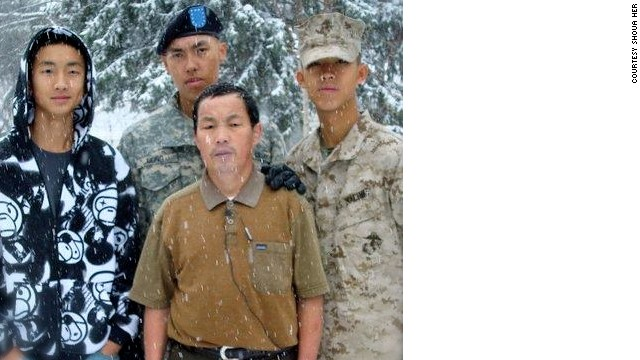 Kham Xiong (in Army beret)  with his father and brothers.