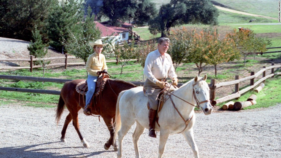 President Ronald Reagan and first lady Nancy Reagan ride horses at their vacation home in Santa Barbara, California, in November 1982.