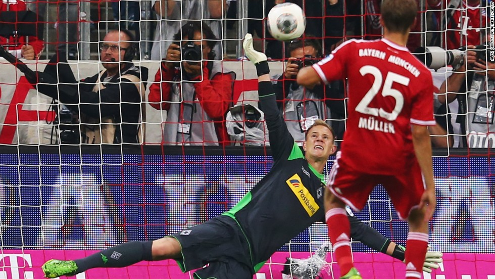 Goalkeeper Marc-Andre ter Stegen of Moenchengladbach saves a penalty from Thomas Mueller of Bayern Munich.