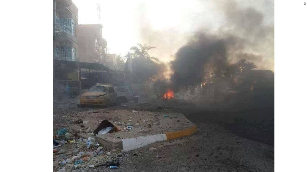 Smoke rises from the scene of a car bomb attack in the Baghdad suburb of Kadhimiya on August 10.