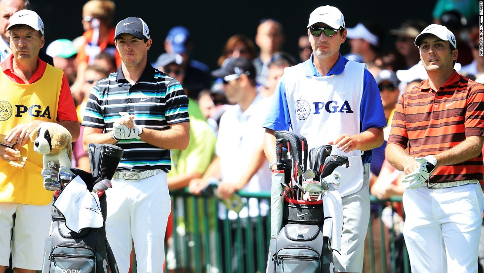 Rory McIlroy, second from left, and Francesco Molinari, far right, await their turn in the third round. McIlroy, the defending champion, trails Furyk by six shots.